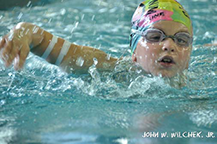 Carly raised funds for diabetes research by swimming 110 laps at Emmaus High School in 2013. Notice the glucose monitor strapped to her right arm.